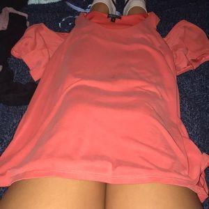 Pink tank off the shoulder shirt.